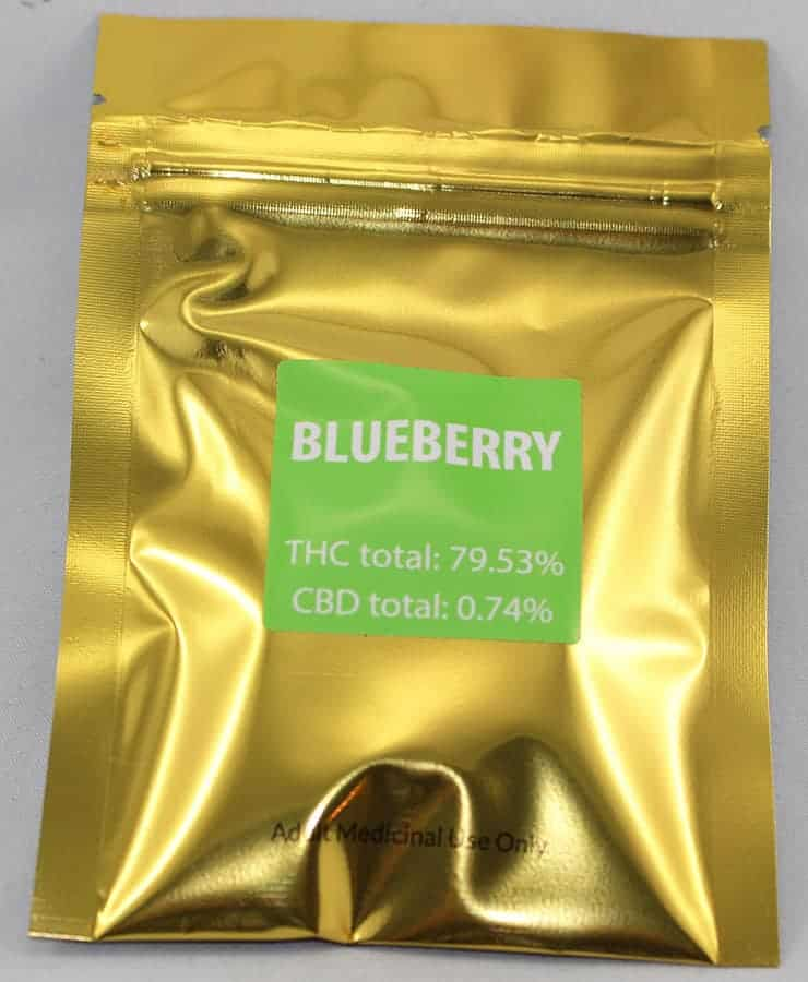 """""""green gold blueberry kush shatter strain in a metalic gold bag"""""""